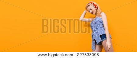 Blonde Cheerful Woman Dj With Red Lips In Blue Striped Shirt On Orange Background With Copyspace Lis
