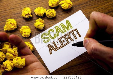 Word, Writing Scam Alert. Concept For Fraud Warning Written On Notebook Note Paper On Wooden Backgro