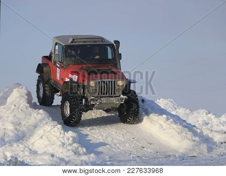 Saltac-korem, Russia - February 11, 2018: Winter Auto Show Of Jeeps - Ice Kneading 2018. Jumping Fro