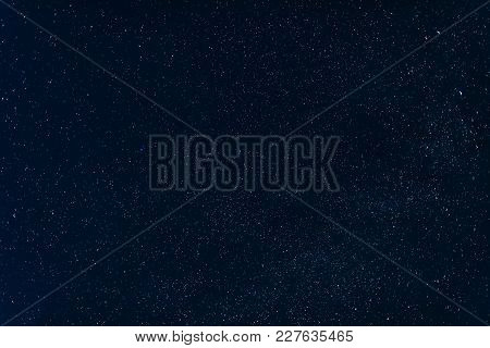 Stars On Dark Blue Sky Background At Night With Milky Way And Nebulae
