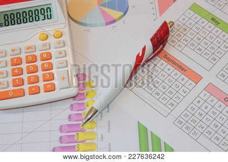 Close Up Business Concept, Calculator, Notebook, Pen On Financial Report On Table Office. Business B