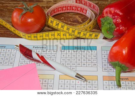 Measure Tape And Fresh Fruit. Healthy Lifestyle Diet With Fresh Fruits. Low-calorie Fruit Diet. Diet