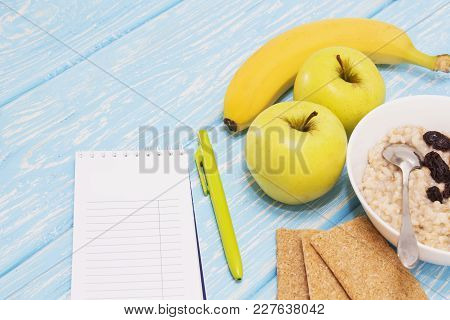 Healthy Diet, Fitness And Weight Loss Concept, Apple, Notepad, Pencil, On The Table. View From Above
