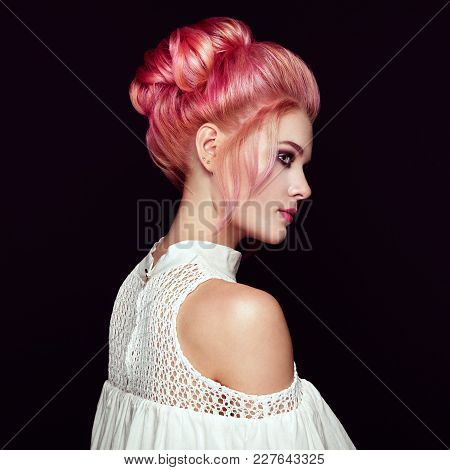 Blonde Girl With Elegant And Shiny Hairstyle. Beautiful Model Woman With Curly Dyed Hairstyle. Care