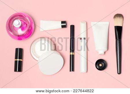 Concept Of A White And Black Cosmetic Supplies Top View On Pink Background. Lipstick, Eyeliner, Brus
