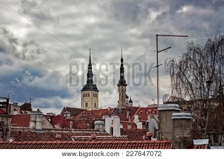 The Church Towers And Television Antennas Reach For The Dramatic Springtime Sky In The Medieval Old