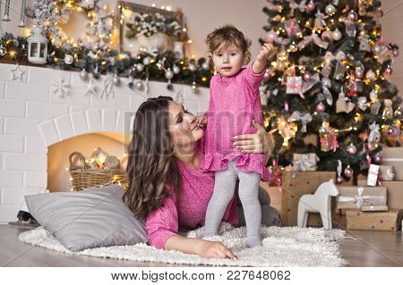 Portrait Of Baby And His Mum In The Studio With Christmas Decorations.