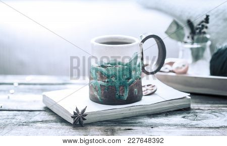 Book And A Cup Of Tea On A Wooden Background