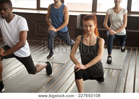 Athletic Sporty Diverse People Doing Lunge Fitness Exercise Step Forward Warming Up At Strength Trai
