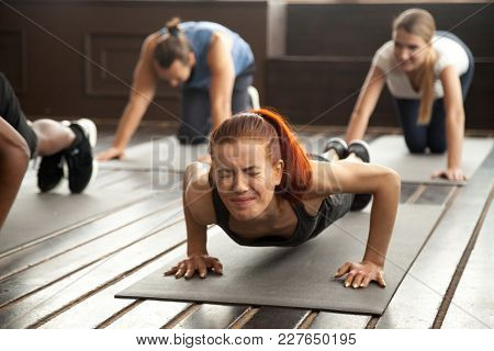 Young Fit Sporty Woman With Painful Face Expression Doing Hard Difficult Plank Fitness Exercise Or P
