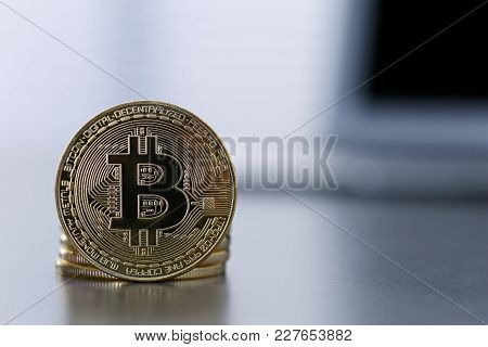 Golden Bitcoin Facing The Camera In Sharp Focus, Close-up. Virtual Anonymous Money Conceptanonymous