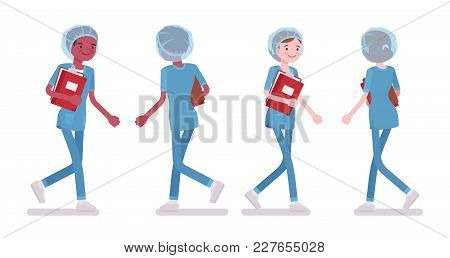 Male, Female Nurse Walking. Young Workers In Hospital Uniform Employed In Clinic, Busy At Work. Medi
