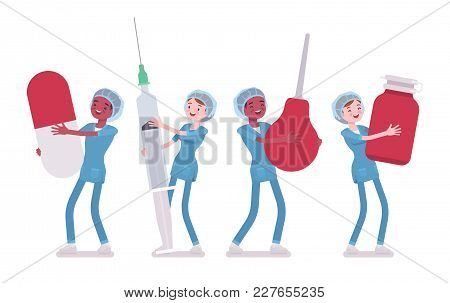 Male, Female Nurse And Big Tools. Young Workers In Hospital Uniform Holding Giant Enema, Syringe, Pi
