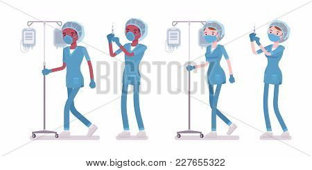 Male, Female Nurse Doing Medical Procedure With Dropper. Young Workers In Hospital Uniform On Duty I