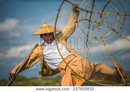 Inle Lake, Myanmar - January 26, 2016 : Close Up Of A Burmese Fisherman On A Traditional Bamboo Boat