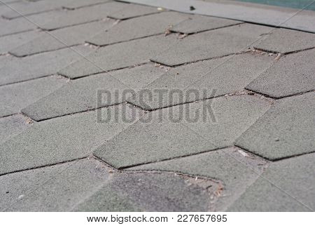 Close Up View On Dirty And Bad Asphalt Roofing Shingles Roof. Roof Shingles - Roofing Construction,