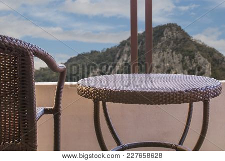 Brown Rattan On Balcony Of Hotel Room