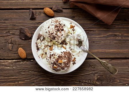 Cold Summer Dessert. Scoops Of Vanilla Chocolate Ice Cream With Nuts In Bowl On Wooden Table. Top Vi