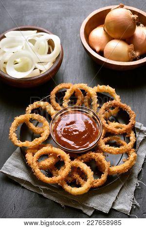 Crunchy Fried Onion Rings On Dark Background