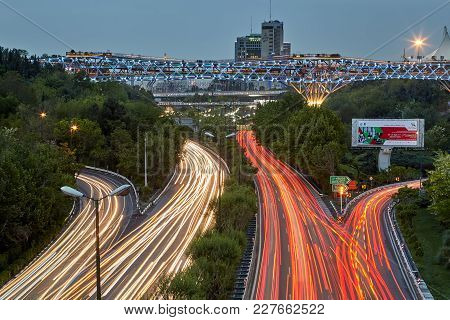 Tehran, Iran - April 29, 2017: Light Trails Of Car Headlights On Modares Highway At Night, And Tabia