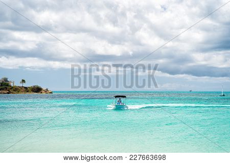 Antigua, Caribbean - March 05, 2016: Motor Boat In Caribbean Sea On Cloudy Sky. Summer Vacation Conc