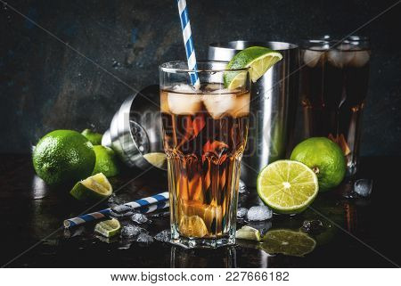 Cuba Libre, Long Island Or Iced Tea Cocktail With Strong Alcohol, Cola, Lime And Ice, Two Glass, Dar