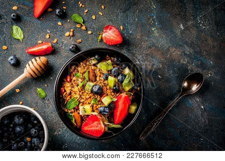 Healthy Breakfast With Muesli Or Granola With Nuts And Fresh Berries And Fruits - Strawberry, Bluebe