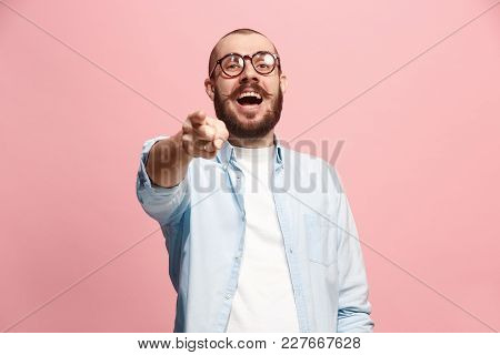 I choose you and order. The smiling business man point you, want you, half length closeup portrait on pink studio background. The human emotions, facial expression concept. Front view. Trendy colors poster