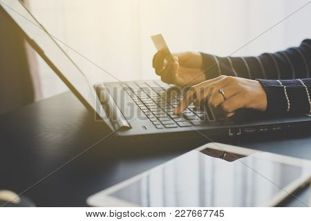 Close Up Of Hand Woman Holding Credit Card And Using Laptop For Online Shopping Concept