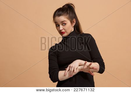 Young Woman With Disgusted Expression Repulsing Something, Isolated On The Pastel