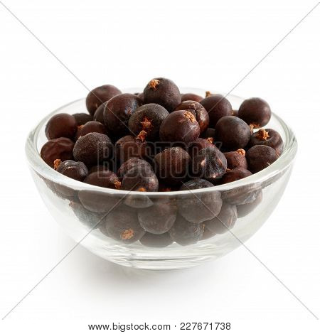 Dried Juniper Berries In Glass Bowl Isolated On White.