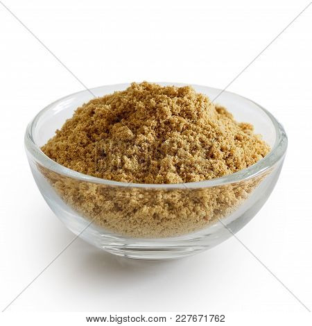 Finely Ground Ginger In Glass Bowl Isolated On White.