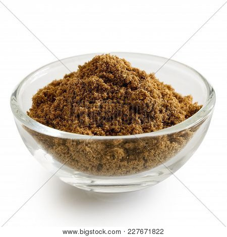 Ground Cumin In Glass Bowl Isolated On White.