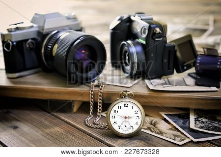 Close Up Antique Pocket Watch, Vintage Photographic Prints, Film Camera And Digital Compact On Aged