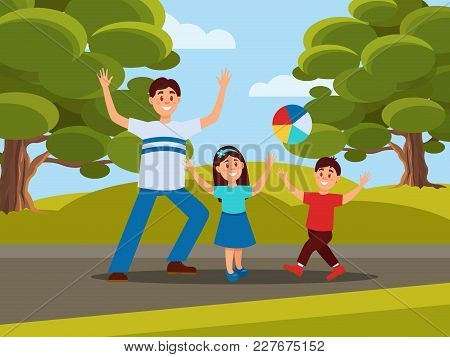 Father With His Little Kids Playing In Ball. Family Recreation In Park. Fatherhood Concept. Outdoor