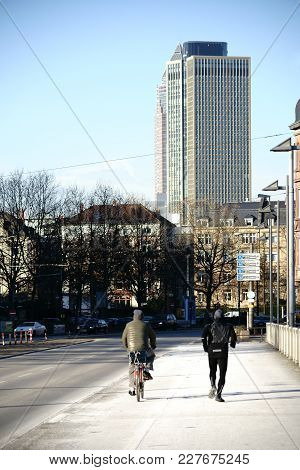 Frankfurt, Germany - January 05: Passers-by In A Side Street In Downtown Frankfurt With The Fair Tra