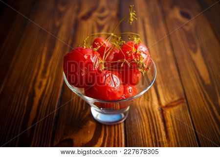 Ripe Red Marinated Tomatoes In A Glass Bowl On A Wooden Table