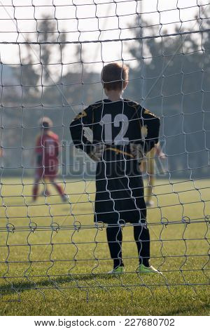 Parma, Italy - September 2015: Little Soccer Player: Goalkeeper With Gloves In Front Of Goal.
