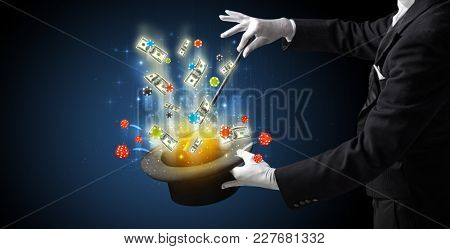 Illusionist conjure with magic wand gambling things from a cylinder