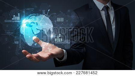 Businessman handing transparent global information flow concept on his hand