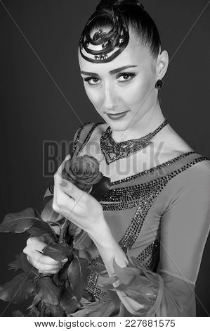Ballroom Dancer With Flower On Dark Background. Sensual Woman With Rose In Dress. Fashion, Beauty, L