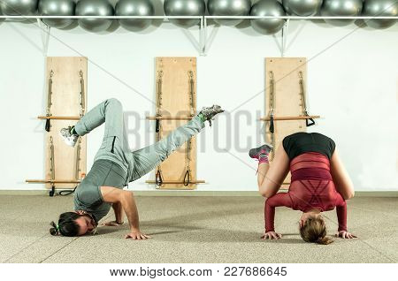 Young Beautiful Fitness Couple Workout Extreme Acrobatic Exercise As Preparation For The Competition