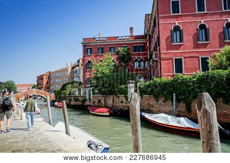 VENICE, ITALY - May 18, 2017 : View of water street and old buildings in Venice on May 18, 2017. its entirety is listed as a World Heritage Site, along with its lagoon