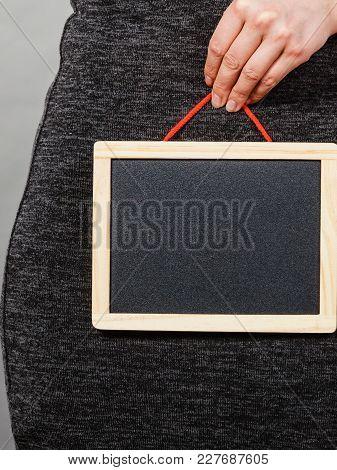 Feminine Body Problems Concept. Woman Holding Blank Black Board On Crotch, Grey Background.