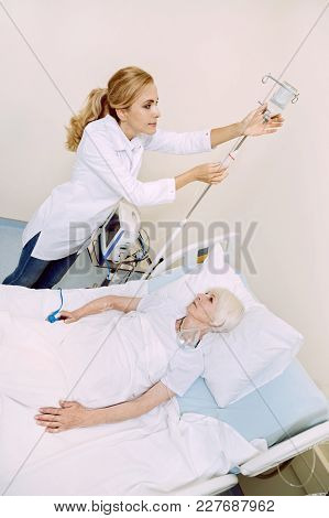 Almost Ready. Top View On A Female Physician Standing Next To Her Senior Patient While Adjusting A D