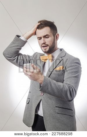 Portrait Of Surprised Business Men Reading Sms On Smartphone.