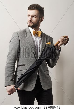 Close Up. Surprised Businessman On Gray Background