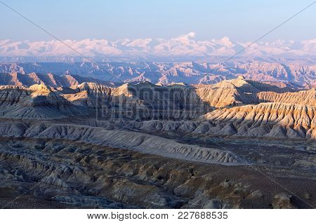 Panorama Of Earth Forest National Geopark And Himalayas At Sunset In Ngari Prefecture, Western Tibet