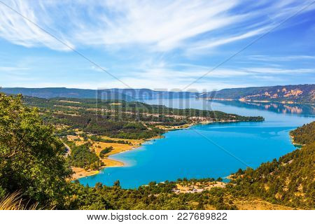 The water in the river is bright azure. The  midday sun. The river Verdon flows along the canyon. Concept of ecological and active tourism