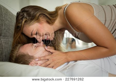 Romantic Cute Couple In Bed Being Intimate